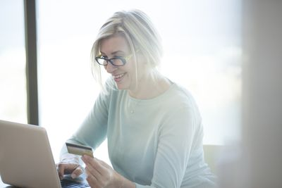 Woman happy because she has established enough credit history for a credit card.