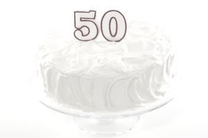 "birthday cake with a number ""50"" candle"