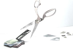 Scissors cutting credit cards