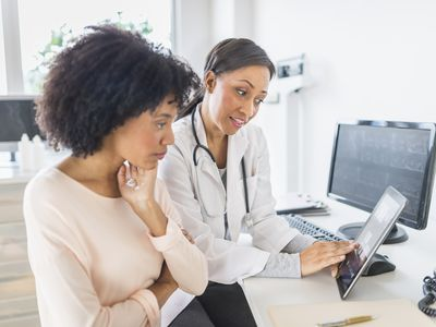 Doctor and patient in office discussing what is a medical necessity
