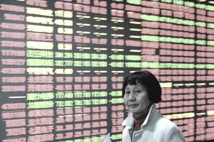 Woman in Front of Chinese Stock Market display