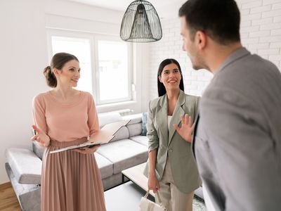 Young couple looking for a new apartment with a real estate agent