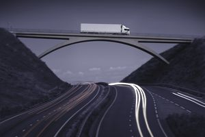 Commercial truck crossing bridge