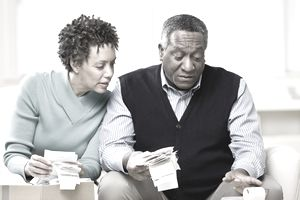 Couple adding up receipts for tax planning.
