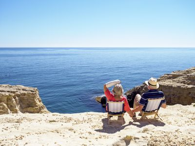Spain, Andalusia, Cabo de Gata, back view of couple looking at the sea