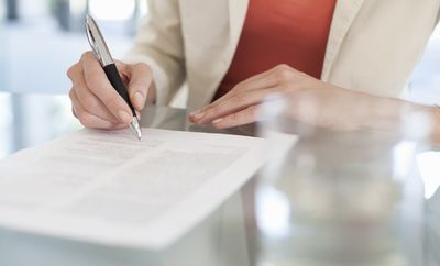 Person signing paperwork in regards to a bank account