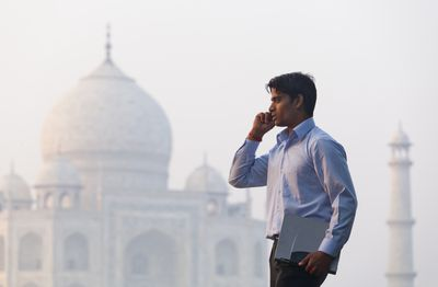 Indian business man with Taj Mahal in background