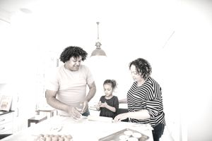 Family in the kitchen baking together