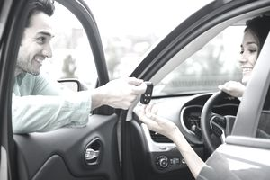 Man giving girlfriend keys to car
