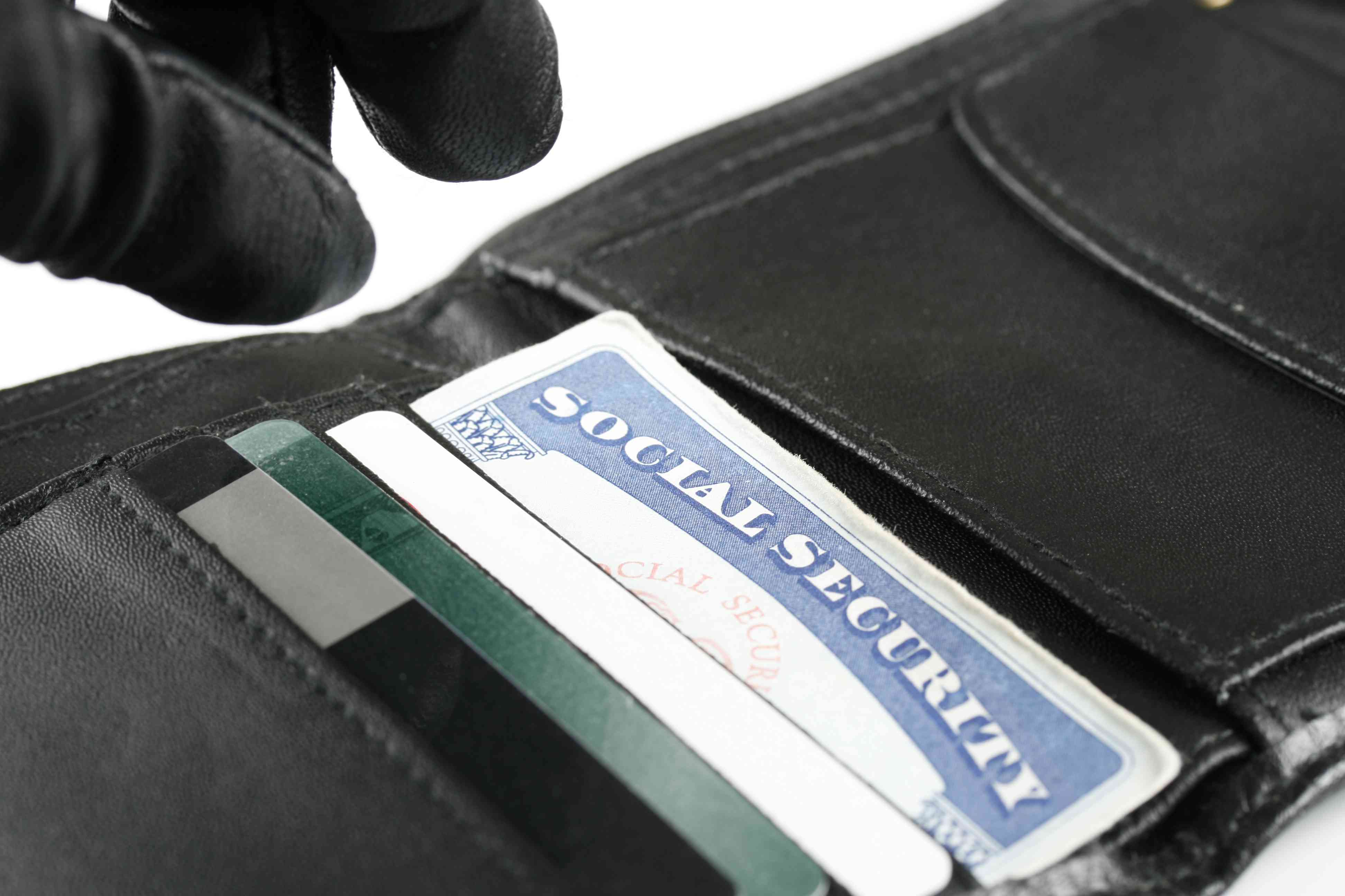 Identity Thief Reaching for Social Security Card in Wallet