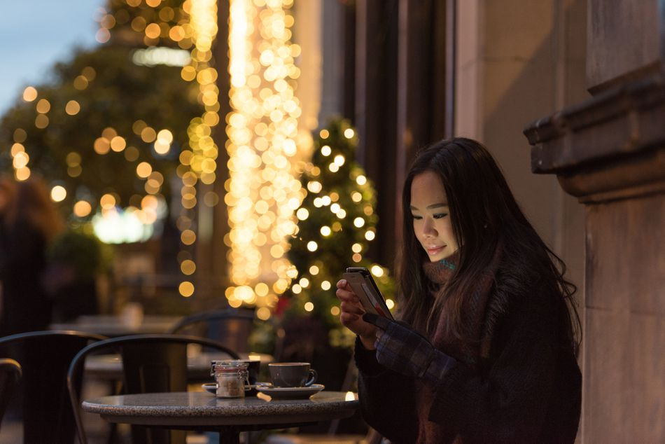 Woman at a cafe during the holiday season