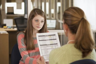 College student talking with financial aid counselor