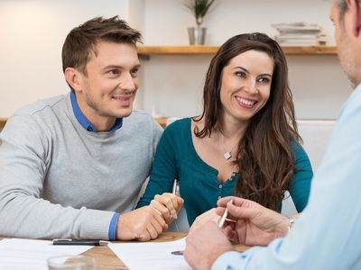 a couple meeting with a financial person