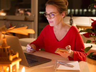 Woman using credit card for online holiday shopping