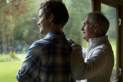 Son discussing a Revocable Living Trust with his father while looking outside