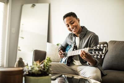 A musician practices a song she will copyright.