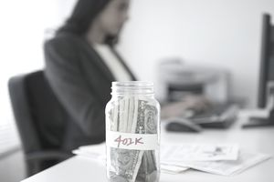 Woman with 401(k) jar