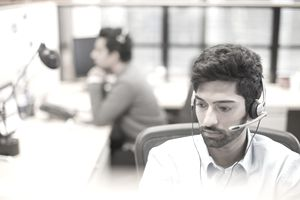 a man wearing headset at desk