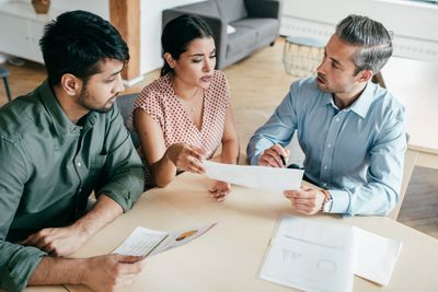 An attorney discusses a sale with his clients