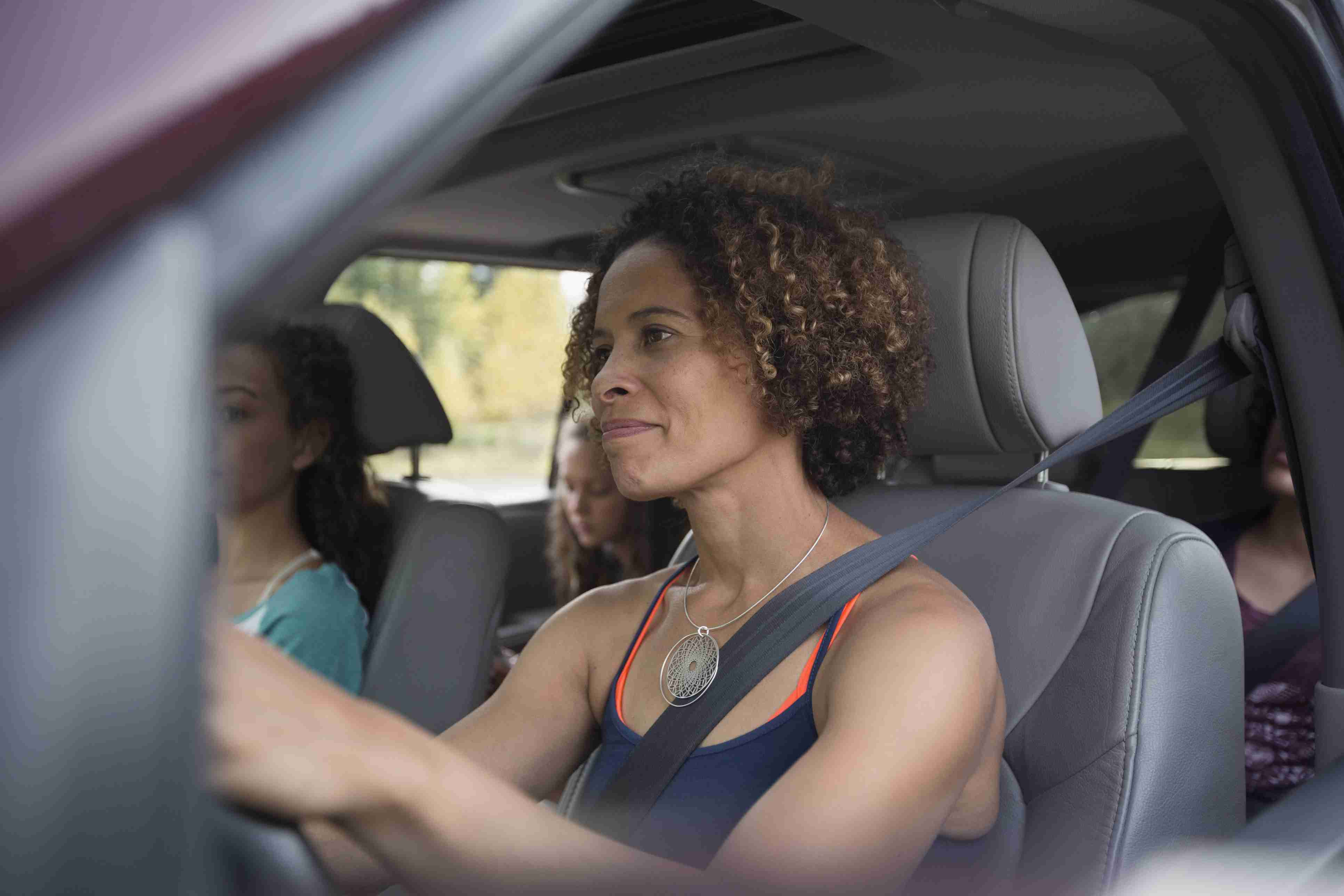 Mother driving daughters in SUV