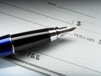 Close-up of pen on a check