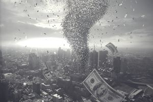 Tornado of money over cityscape