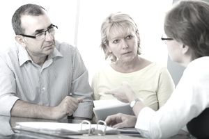 Couple learning about witholdings on retirement plan distributions.