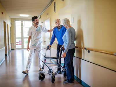 Senior person walking with support.
