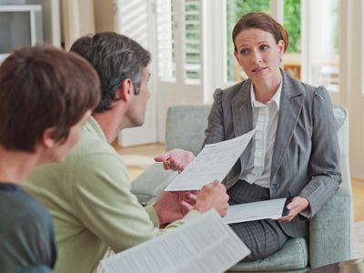 Loan advisor discussing loan options with a couple