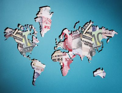 Map of world made of various currency