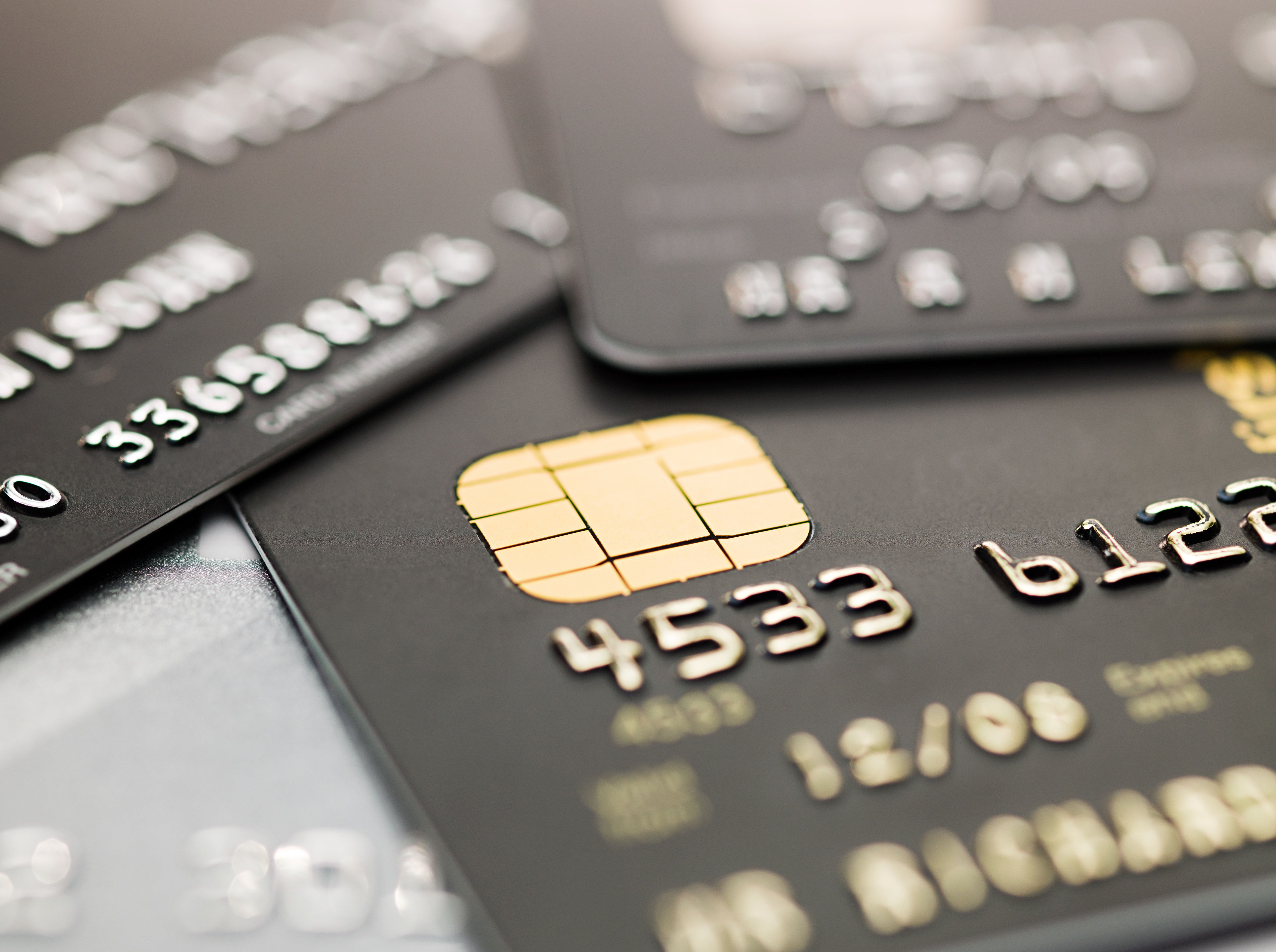 A close-up view of credit cards laying in a stack