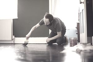 Man painting floor