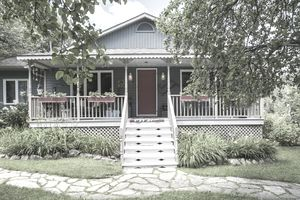 An older patio home with a porch out front is cute as a bug.