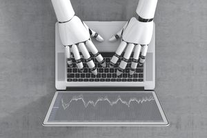 robot hands typing on a laptop keyboard