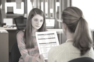 Young female student talking with financial aid counselor