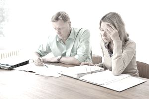 Mature couple calculating home finances
