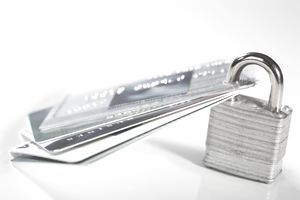 Close-up of credit cards with a padlock