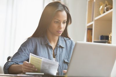 A woman paying bills online
