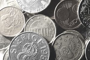 Various coins in pile.