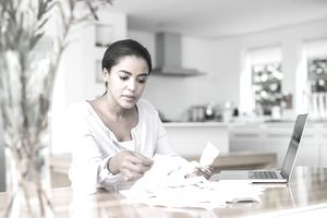 woman reading bills and making a budget