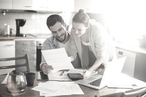 Couple reviewing financial documents