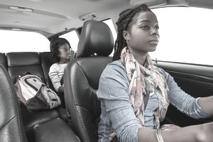 Woman drives SUV with daughter in back seat