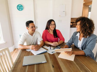 Couple at table with finance professional