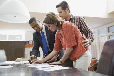 Couple signing documents for financial advisor