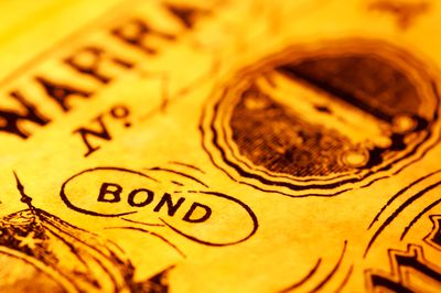 A close-up of the word bond with a yellow tint
