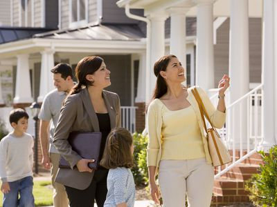 Relator Showing House to Young Family