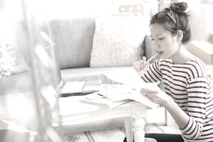 A young woman reviews her debt as she researches personal loans.