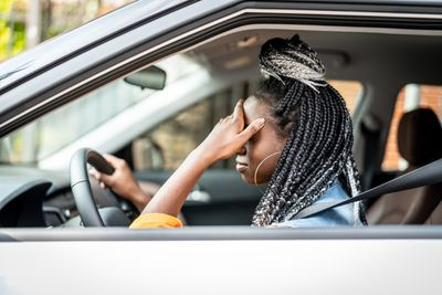 stressed woman in car