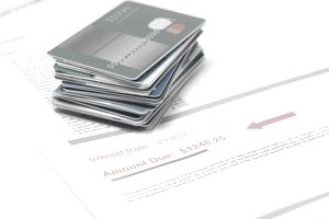 Stack of credit cards on account of value in red