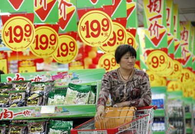 A customer purchases goods at a supermarket in Huaibei, Anhui Province of China.